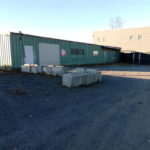 Outdoor picture of garage door of warehouse for commercial lease in Anchorage, Alaska