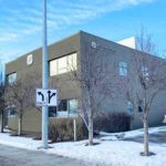 Downtown office building in Anchorage Alaska for sale. Clear skies.